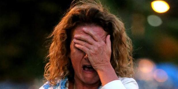 Zaza Silk breaks down after freak waves destroyed her pool. Photo / News Corp Australia / John Grainger