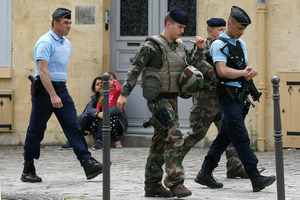 Soldiers and police keep guard near the England soccer team hotel in Chantilly, France. Photo / AP