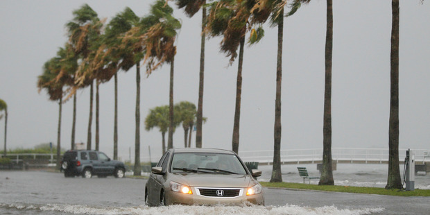 A vehicle moves through water from Tropical Storm Colin in Gulfport, Florida. Photo / AP
