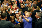 Democratic presidential candidate Hillary Clinton takes a selfie with supporters at a rally at California State University, San Bernardino. Photo / AP