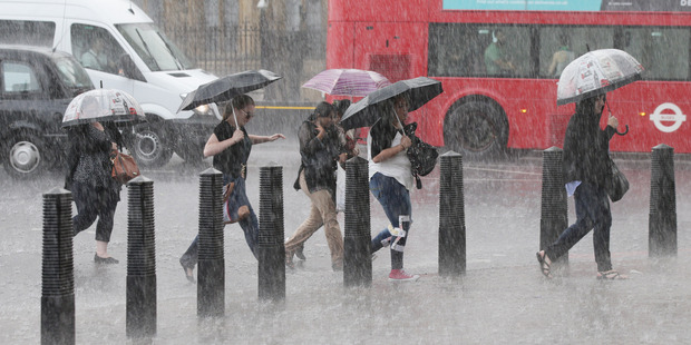People in Westminster, central London. Photo / AP