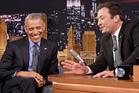 President Barack Obama, left, laughs while listening to host Jimmy Fallon. Photo / AP