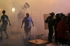 A chair flies through the air during clashes between police and England supporters in downtown Marseille. Photo / AP