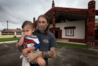 Homeless father of four, Tony Lepage with his 2 year-old son Tangaroa, has had to seek accommodation at Te Puea Marae, Mangere Bridge. Photo / Brett Phibbs