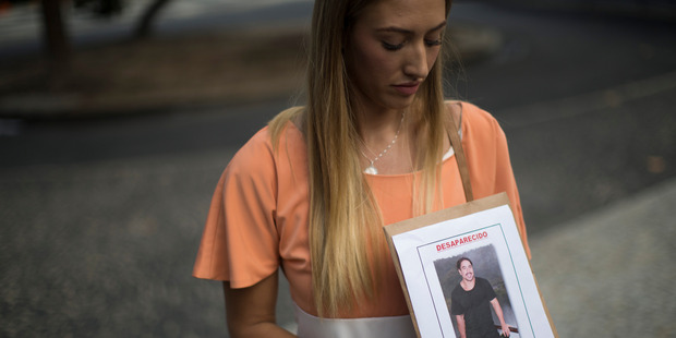 Bonnie Cuthbert, of Australia, shows a photo of her missing boyfriend Rye Hunt, 25, during a press conference in Rio de Janeiro, Brazil, Friday, June 3, 2016. Photo / AP