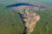 The Batagaika Crater in Siberia, which is widening every year.