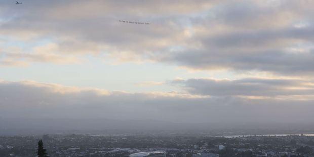 Loading Plane flies over Eden Park.