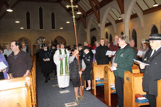 Cross-bearer Andreas Jackson leads Reverend Jo Crosse and St John officials into the church.