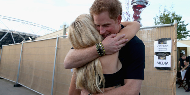 Prince Harry hugs Ellie Goulding backstage at the 2014 Invictus Games Closing Ceremony. Photo / Getty Images