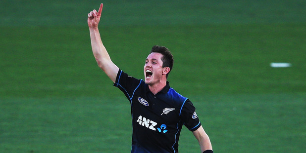 Loading Adam Milne of the Black Caps celebrates taking a wicket against Australia in February. Photo / Getty Images