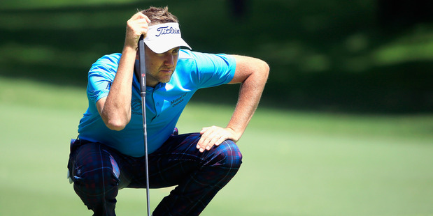 Ian Poulter lines up a putt during the DEAN & DELUCA Invitational. Photo / Getty Images