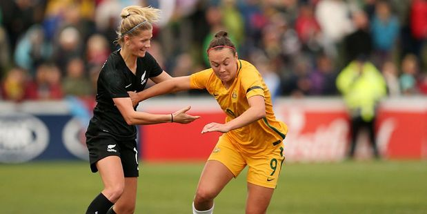 Caitlin Foord of Australia and goal-scorer Katie Bowen of New Zealand compete for the ball. Photo / Getty
