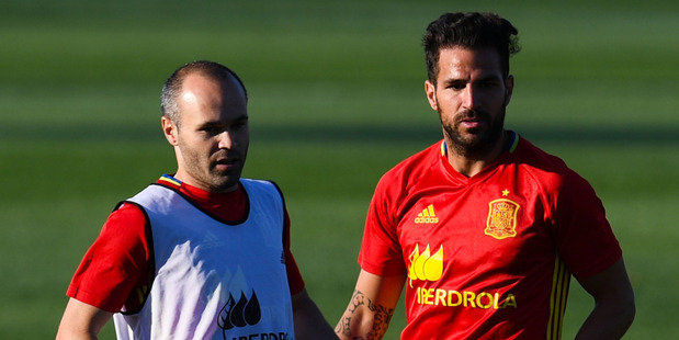Andres Iniesta (L) and Cesc Fabregas of Spain in action during a training session at La Ciudad Del Futbol de las Rozas. Photo / Getty Images