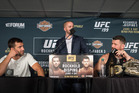 Michael Bisping (right) insults Luke Rockhold during a press conference after their fight at UFC 199. Photo / Getty Images