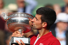 Novak Djokovic kisses the French Open trophy. Photo / Getty Images