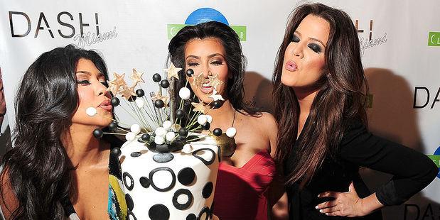 Kourtney Kardashian, Kim Kardashian and Khloe Kardashian arrives at the Grand Opening of Dash Miami at Clevelander Hotel. Photo / Getty Images