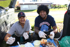 Warrior player James Gavet feeds the homeless of Auckland with his sister Riverlina. Photo / Doug Sherring