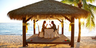 The beachfront at Crown Beach Resort is the perfect spot to enjoy a cocktail at sunset. Photo / Cook Islands Tourism