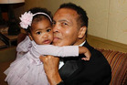 Former heavyweight boxing champion of the world Muhammad Ali with his granddaughter Sydney, daughter of Ali's daughter Laila. Photo / Facebook