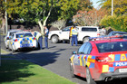 Police attend the scene of the dog attack on Emily St in Gisborne. Photo / Gisborne Herald