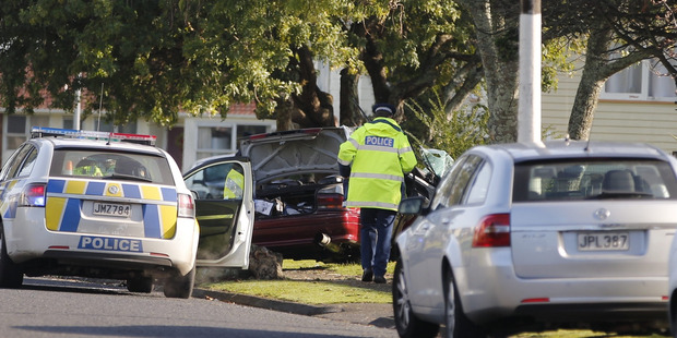 Loading Four people were in this car when it crashed into a tree in Mangere this morning. Photo / Michael Craig