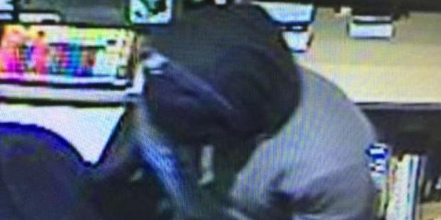 Image of one of the men involved in the robbery at Merivale TAB. Photo / Supplied