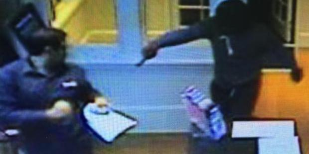 Security camera footage shows the aggravated robbery taking place at Merivale TAB in Christchurch. Photo / Supplied
