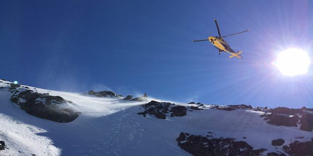 Taranaki Rescue helicopter attending to a fallen climber. Photo / Supplied