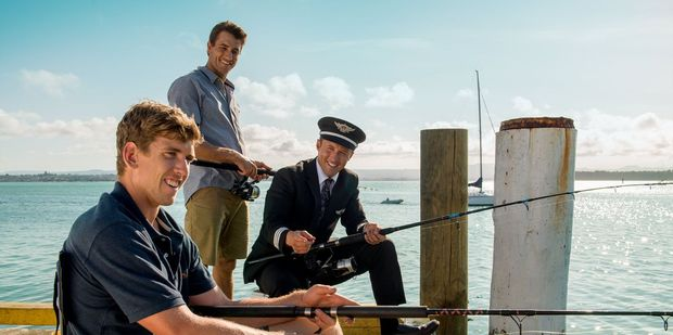 Tauranga's Peter Burling and fellow sailor Blair Tuke meet an Air New Zealand captain  for a spot of fishing at Salisbury Wharf. Photo/supplied