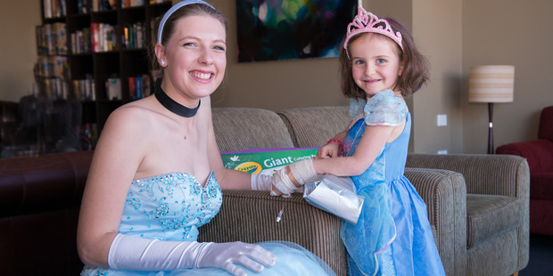 Cinderella visits to see Saoirse Gaffney a brave little princess battling cancer. Photo / Hannah Gale Photography