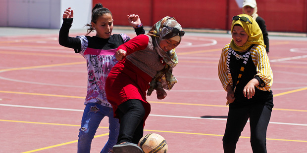 An after-school football game for the girls at Azraq Refugee Camp in Jordan. Photo / World Vision