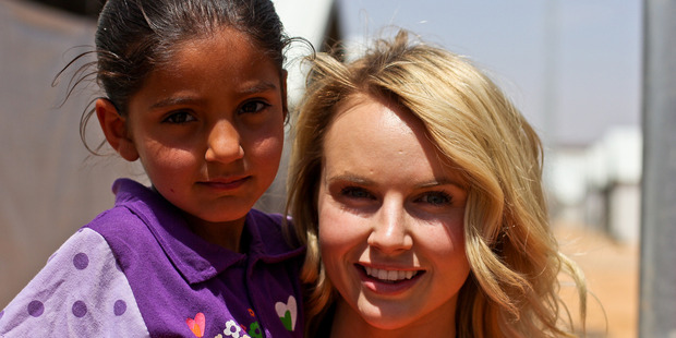 Kim Crossman with a young Syrian refugee living in the Azraq Refugee Camp in Jordan. Photo / World Vision