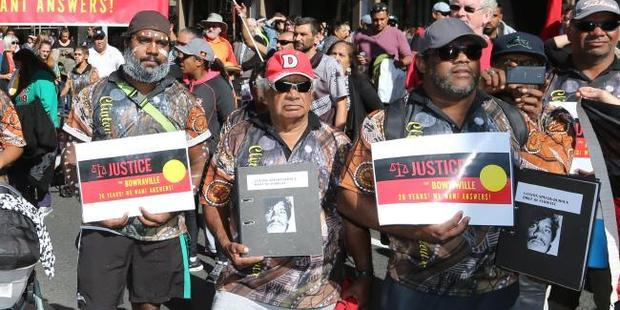 The community of Bowraville protest outside NSW Parliament about the lack of action over the murders of three Aboriginal children from the country town 26 years ago. Photo / News Corp Australia