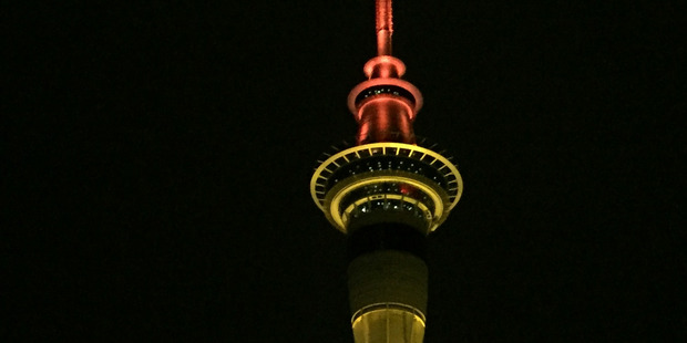 The Sky City Sky Tower is illuminated orange for the 40 Hour Famine this weekend. Photo / Greg Bowker