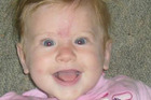 Two-year-old Emily Saunders is missing after being swept away in the flooded Poerua River near Greymouth. Photo / via Facebook