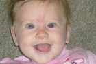 Emily Saunders, 2, is missing after being swept away in the flooded Poerua River near Greymouth. Photo / Facebook