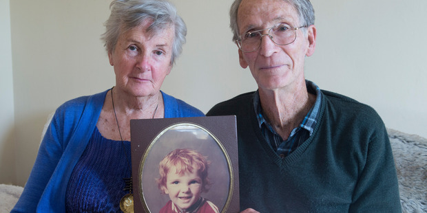 Dave and Marlena Peacock with a portrait of their son Ashley, who has spent more than five years locked in virtual seclusion at a mental health unit. Photo / Mark Mitchell
