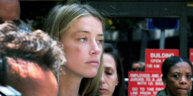 Actress Amber Heard leaves Los Angeles Superior Court court, after giving a sworn declaration that her husband Johnny Depp threw her cellphone at her during a fight. Photo / AP