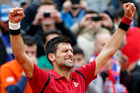 Serbia's Novak Djokovic raises his arms in victory after defeating Austria's Dominic Thiem during their semifinal match of the French Open tennis tournament. Photo / AP.