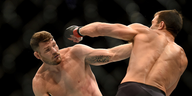 Michael Bisping, left, fights Luke Rockhold during a UFC 199 at the Forum in Inglewood, Calif., Saturday June 4, 2016. Photo / AP.
