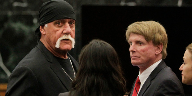 Hulk Hogan, whose given name is Terry Bollea, left, looks on in court moments after a jury returned its decision in Floride. Photo / AP