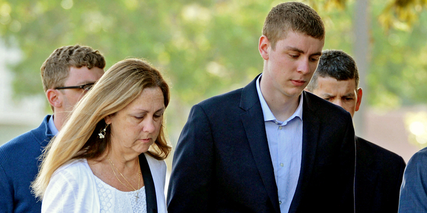 Brock Turner, right, makes his way into the Santa Clara Superior Courthouse in Palo Alto.