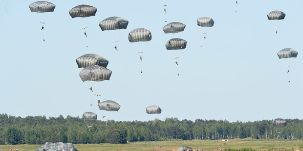US troops land with parachutes at the military compound near Torun, central Poland. Photo / AP