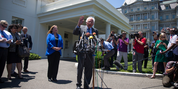 Bernie Sanders, accompanied by his wife Jane Sanders, speak to reporters outside the White House in Washington. Photo / AP