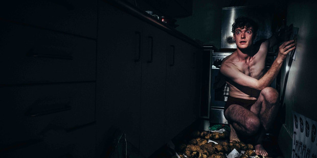 Andrew Gunn acts out a manic episode when he hung groceries from the ceiling and urinated in crockery.