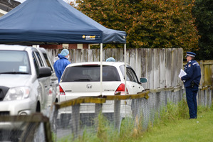 Police at the home where the three-month-old baby lived on 19th Ave, Tauranga. Photo / George Novak