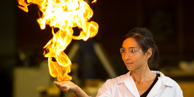 Scientist Dr Michelle Dickinson, aka Nanogirl, sets fire to chemicals in her hand. Photo / Jason Oxenham