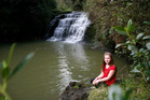 Mikayla Bourne by a waterfall in Lucas Creek, one of the waterways targeted by the Green Party. Photo / Garry Brandon