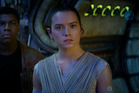Actress Daisy Ridley stars as Rey in the movie, Star Wars: The Force Awakens.