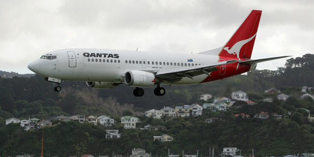 A Qantas Boeing 737 on approach for landing at Wellington Airport. Photo / Mark Mitchell